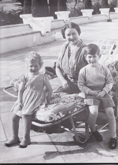 the queen mum with princess anne and prince charles.