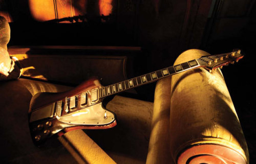 Daniel Lanois' Firebird V Lanois' '60s Gibson Firebird V—which he loves to plug into a cranked amp for delicate fingerstyle work—rests on a golden divan. Photo by Melinda Dahl