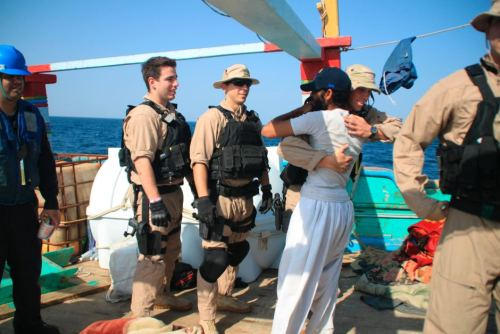 adventures-of-the-blackgang:  mabelmoments:  A US sailor greets a crew member of the Iranian-flagged dhow Al Molai after rescuing the fishing vessel from pirates in the Arabian Sea on  January 6, 2012. Reuters: US Navy More pics like this in the news, please.   A US Navy Sailor aboard a safety boat observes a visit, board, search and seizure team assigned to the guided-missile destroyer USS Kidd (DDG 100) board the Iranian-flagged fishing dhow Al Molai (U.S. Navy photo/Released) source: gcaptain US Navy Detains Pirates, Rescues Iranian Crew [VIDEO/IMAGES]   Go Navy!!!