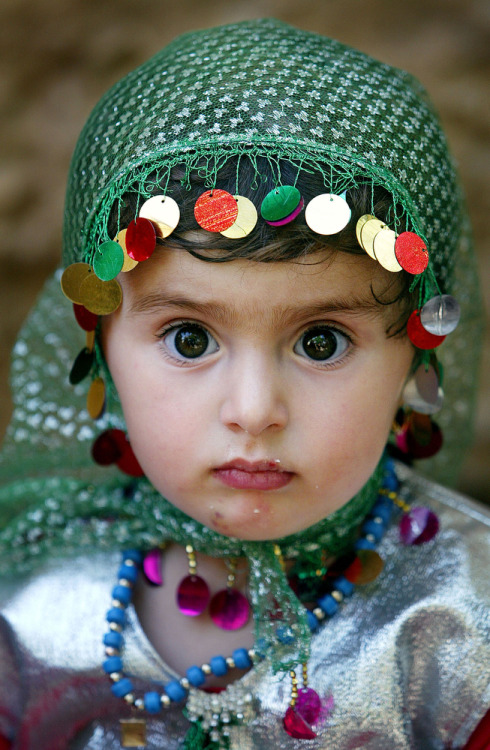 A Kurdish girl, Leiwan, 2, attends a traditional wedding celebration June 15, 2003 in Bakochek, Iraq. Saddam Hussein's regime killed an estimated 180,000 Kurds from 1988-1991 in a genocidal campaign involving both chemical and conventional weapons. (Photo by Mario Tama/Getty Images) (via Photos: The most memorable photos from the Iraq War | Plog — World, National Photos, Photography and Reportage — The Denver Post)