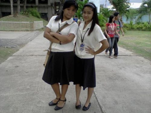 amputatedmind:  Christa and Me in our College Uniform. :D  <3 baskug!