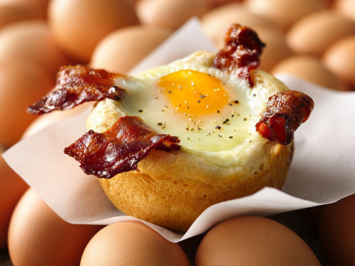 Bacon and Egg Savory Cupcakes Recipe by Betty Crocker Recipes on Flickr. INGREDIENTS: 16 slices bacon 1 can (16.3 oz) Pillsbury® Grands!® Homestyle refrigerated buttermilk biscuits 8 eggs Salt and pepper, if desired DIRECTIONS: 1. Heat oven to 350°F. In 10-inch skillet, cook bacon over medium heat about 4 minutes or until cooked but not crisp, turning once. (It will continue to cook in the oven.) Set aside. 2. Spray 8 jumbo muffin cups or 8 (6-oz) glass custard cups with cooking spray. Separate dough into 8 biscuits. Place 1 biscuit in each muffin cup, pressing dough three-fourths of the way up sides of cups. Place 2 bacon slices in each biscuit cup, and crack an egg over each. Season with salt and pepper. 3. Bake 25 to 30 minutes or until egg whites are set. Run a small knife around cups to loosen. Serve immediately.
