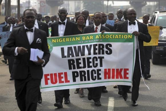 Members of the Nigerian Bar Association carry a banner as they walk  along a street to protest a fuel subsidy removal, in Lagos, January 5,  2012.  Photo by REUTERS/Akintunde Akinleye