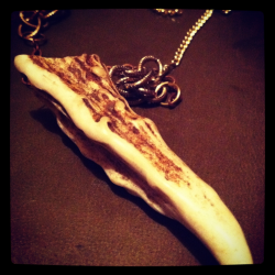 Deer antler point necklace with mix matched gold chains. Now at Paxton Gate on N Mississippi Ave. Portland, Oregon.