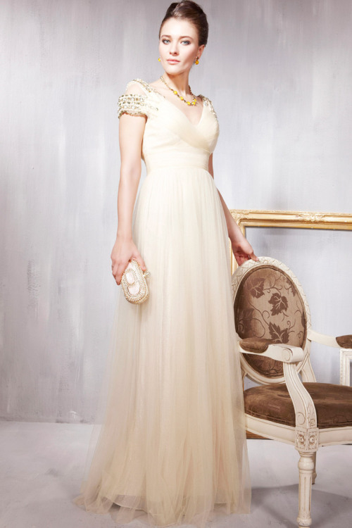 Divine Champagne Evening Dress With Sleeves £280.00  Holiday evening dress in divine champagne colour featuring A Line silhouette with sheer chiffon overlay in the skirt, belted waist, and multiple embellished straps in gold and yellow stones. Send us a message to inquire about plus sizes or if you want this dress for another colour. :)