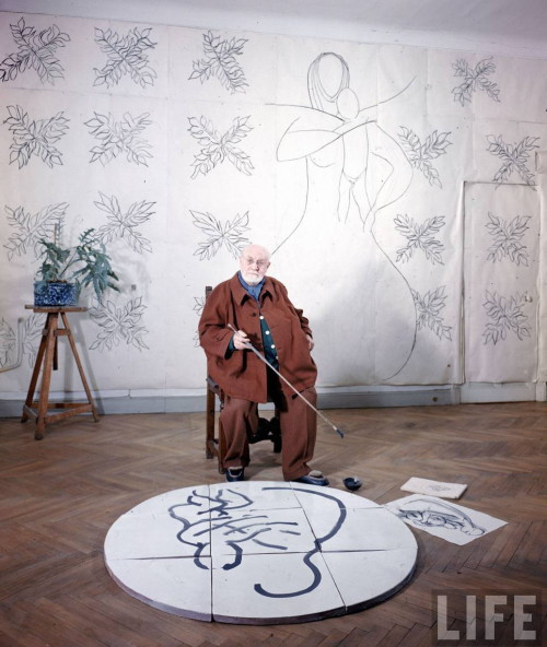 "artistandstudio:  Henri Matisse in his studio working with a sketch of ""The Virgin and Child"" for his chapel at Vence, France, 1950.  Photo by Dmitri Kessel"