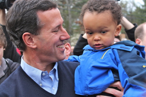 Candidate Rick Santorum holds 17-month-old Mark Stephen at a meet-and-greet event in Amherst, NH on Saturday. Photo by Heather Caygle, American Observer.