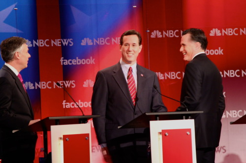 Republican candidates Jon Huntsman, Rick Santorum and Mitt Romney have a friendly chat during a commercial break at the Meet the Press/Facebook debate Sunday. Photo by Emily Roseman, American Observer.