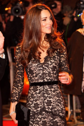 fashionsnitch:  Kate Middleton attending the London Premiere of War Horse, in a gorgeous black lace Temperley gown.  Lovely though she could do with a bit of booty. Then again she's English, so that probably won't happen. Side note: I'm loving the re-emergence of lace lately.