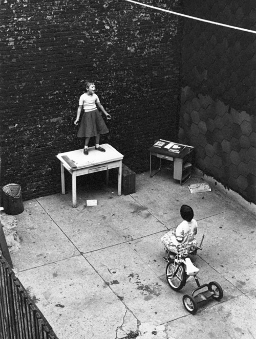 William Gedney Girl standing on desk in courtyard, performing for a seated girl, 1955 Thanks to wonderfulambiguity