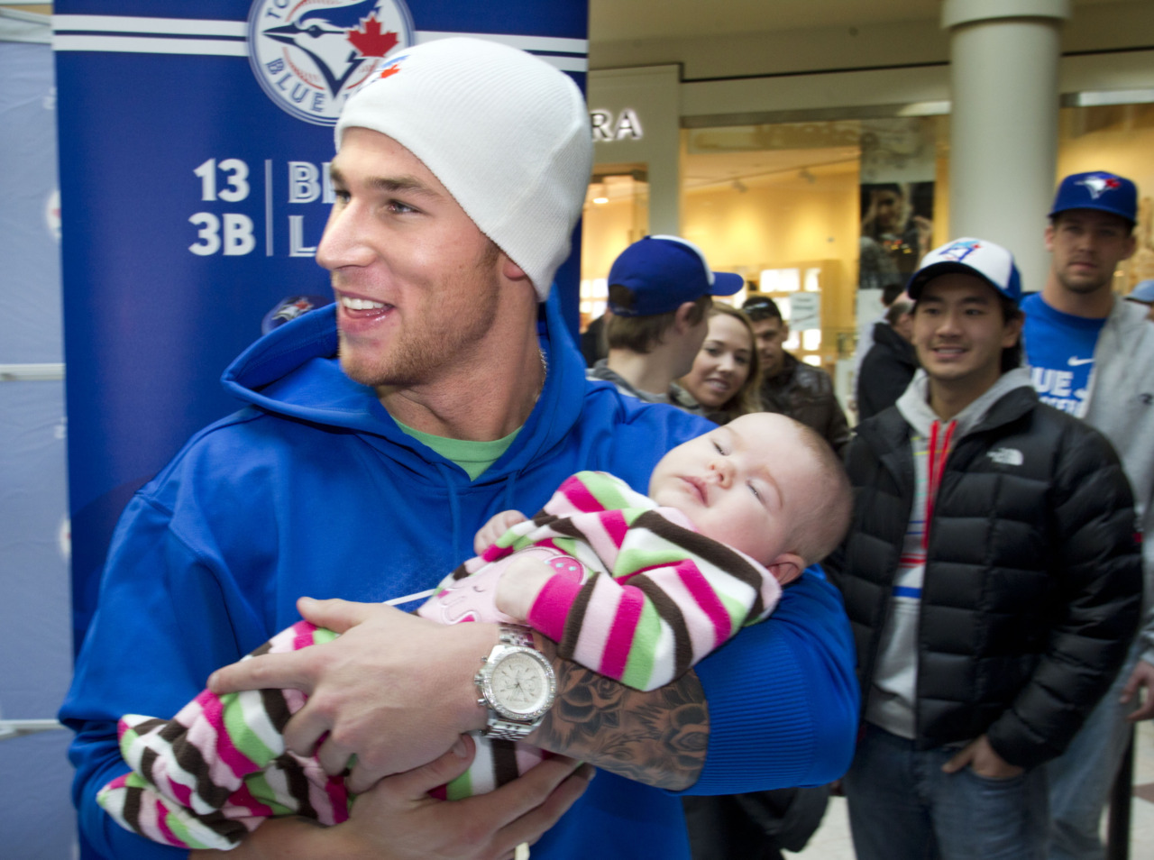 Sports-related baby photo of the day: The Blue Jays' Brett Lawrie with two and Aislyn Farquharson. Members of the Toronto Blue Jays stopped by the St Laurent Shopping Centre in Ottawa to meet with fans and sign autographs.The Post's John Lott writes on manager John Farrell. For his team to contend in 2012, he says, Brett Cecil and Colby Rasmus must snap out of their 2011 stupors.His narrative fans out from there, focusing first on a problematic rotation and pausing for a look at the question marks in left field, with a few other brow-knitting stops along the way.Farrell's conclusion: His Toronto Blue Jays, as currently constituted, have what it takes to win 10 more games and make the playoffs this year. Photo: Chris Mikula/Postmedia News