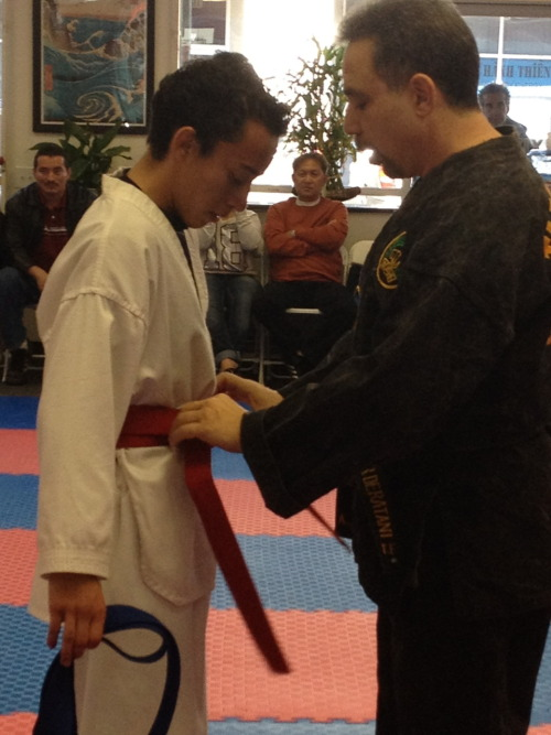 Orlando receiving his very well deserved red belt!
