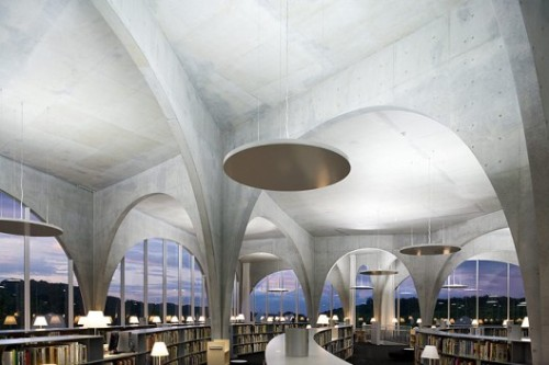"""With its iconic arches, Toyo Ito's new library at Tama Art University has the aura of a Romanesque building. But caves, not compression structures, were the architect's inspiration, so any similarities to European antecedents are merely superficial. And unlike the straightforward, repetitive systems used historically, Ito's high-tech concrete curves—each one different—tiptoe gracefully in multiple directions throughout the building.A continuous sheet of concrete, the building's cavernous ground floor flows down to the north, following the land's natural slope. It reads as a unified, slanting space accessed through an arcaded gallery. A circulation conduit and multipurpose exhibition hall all in one, this informal gallery has plenty of room for students to congregate around one of its built-in tables or display their work, be it a painting or a performance piece. It also acts as the entry foyer leading into the library, whose ground level contains the circulation desk, an administrative area, a media bar, and magazine display tables topped with glass that parallel the angled floor. A set of stairs shaped like a floating curlicue of concrete ascends to the second floor, where the main reading area flows into open stacks on one side and a two-story block of closed stacks on the other. Unlike downstairs, the floor plane here had to be level for the book trolleys that transport the library's 10,000 volumes. But overhead, the ceiling tilts up gently, filling the entire second floor with soft, north light."""