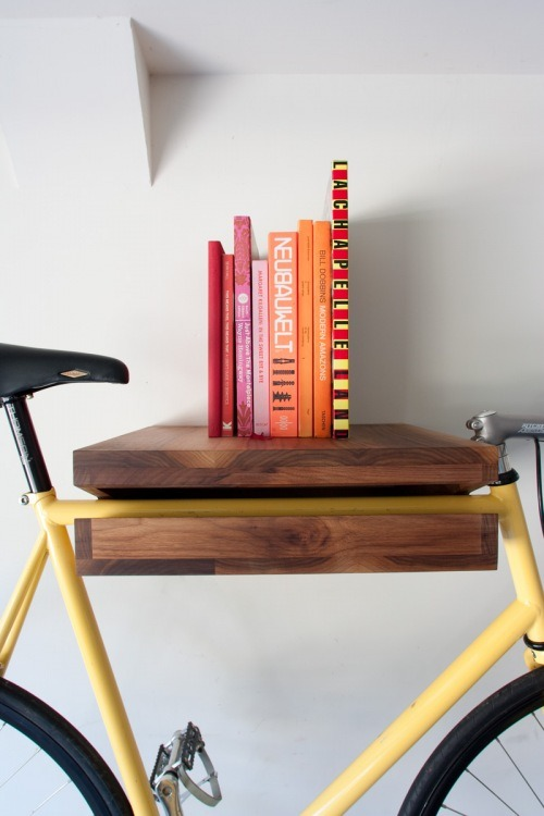 morethis:  (via Bike Shelf |) If my building didn't have a bike room, I would have THIS.   this and other bike storage solutions look real nice and all, but they really tend to not play well with my hybrid with a (straight but angled) drop bar. Here's to a future with stylish bike accessories that don't assume you have a road bike frame!