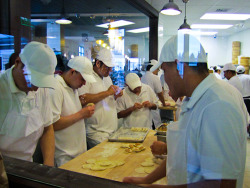 It's literally an assembly line at Din Tai Fung in Bellevue, Washington. They specialize in shanghai dumplings but their spicy wontons are delicious!
