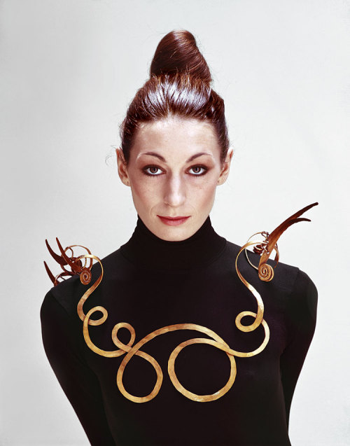 Anjelica Huston wearing Alexander Calder's The Jealous Husband, made of brass wire in 1940.