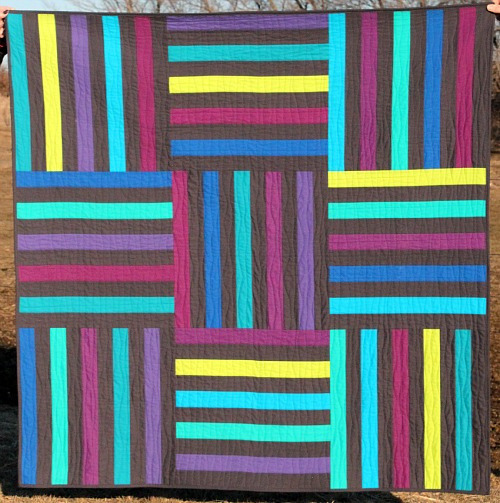Modern Stix Quilt by Megan, an original design featured on her blog. She also sells the pattern in her shop.