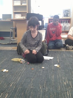 Giving a lesson on playing dreidel