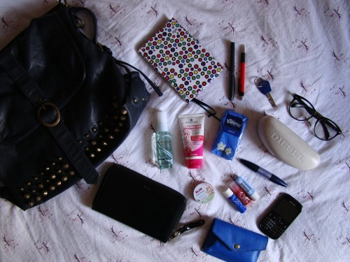 "I  absolutely adore reading ""what's in my handbag"" blog posts, especially  from my favorite bloggers so I thought it would be lots of fun to compose  a little nosy post about the contents of my bag lately. Here's what's hanging out in there currently… a planner called ""Ženski rokovnik"", pens, dorm room keys, nerdy glasses from Proopticals, Diesel glasses bag, tissues, hand moisturizer, FCUK body spray, Mango wallet, Hipp Babysanft cream, lip gloss, Labello x 2, Nivea mascara, my mobile phone and H&M mobile phone pouch. Hope you've enjoyed this little peek in my bag! Have a lovely lovely day! :)"