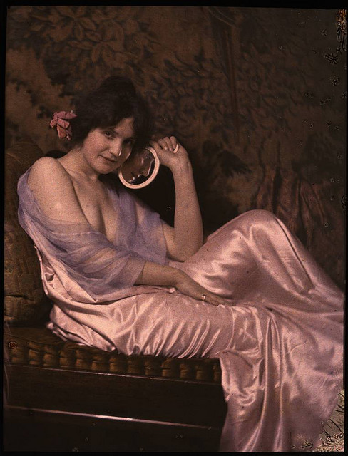 publicdomainthing:  Woman in satin dress holding a mirror  1915 George Eastman House Collection  A lushly different perspective on the Edwardian Age.
