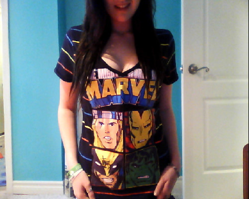 Showing off a marvel shirt.