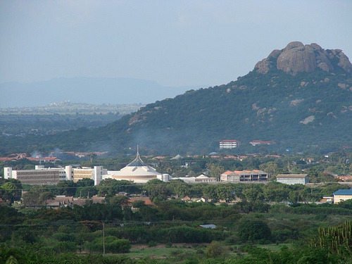 "The capital of Tanzania is not Zanzibar or even Dar-es-Salam but DODOMA. It is right in the middle of the country. Dodoma means ""it has sunk"" in the Gogolanguage. Tanzania's National Assembly moved there in February 1996, but many government offices remain in the previous national capital, Dar es Salaam, which remains the commercial capital."