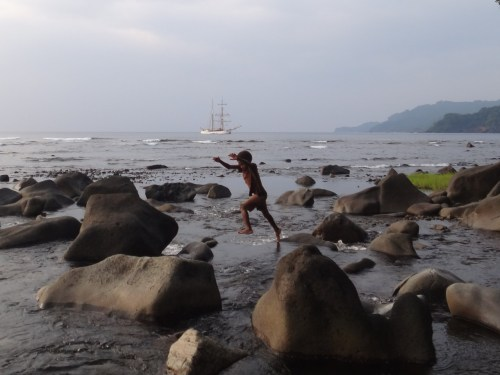 Youngster hopping the rocks in the river as Tall Ship Soren Larsen rests at anchor, Vanuatu, Sept 2011, Marsha Book