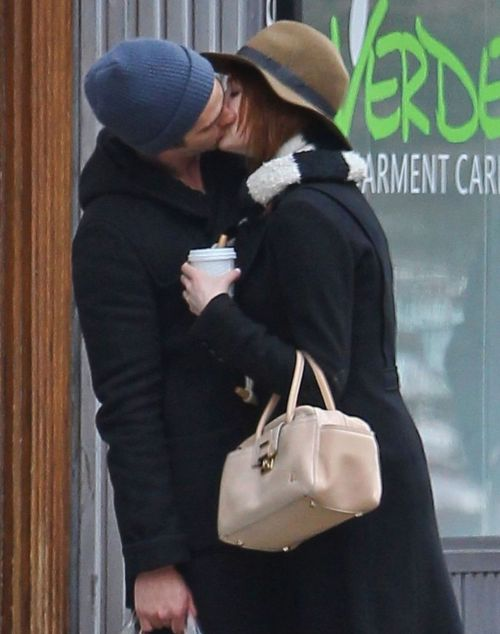 Emma Stone & Andrew Garfield engage in some PDA as they go for a  romantic stroll in New York City - January 8th, 2012.