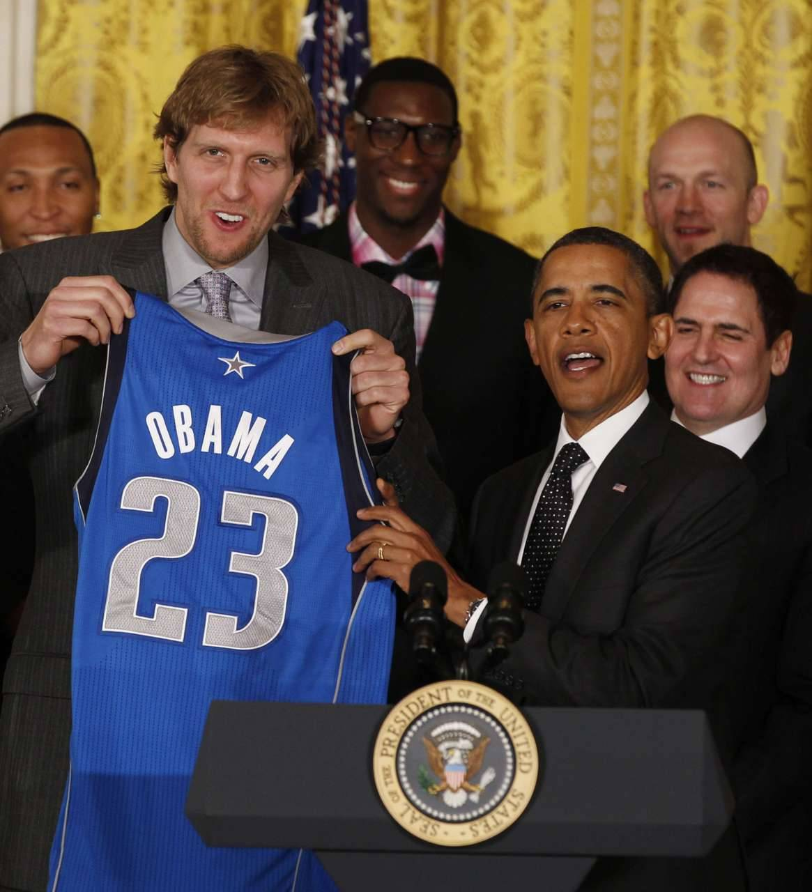 nationalpostsports:  Meet the Mavericks' newest memberJust kidding. U.S. President Obama receives a team jersey from Dallas Mavericks forward Dirk Nowitzki (L) while hosting the 2011 NBA champions in the East Room at the White House in Washington, January 9, 2012. At right behind Obama is team owner Mark Cuban. REUTERS/Larry Downing