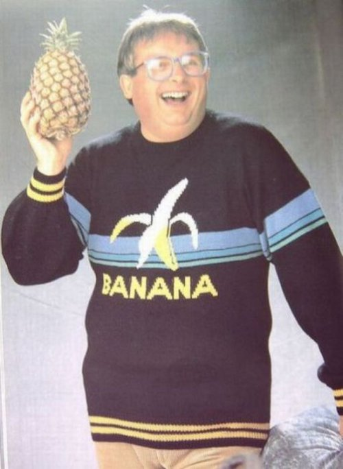Man In Banana Sweater Holding A Pineapple   Just let him have this one.