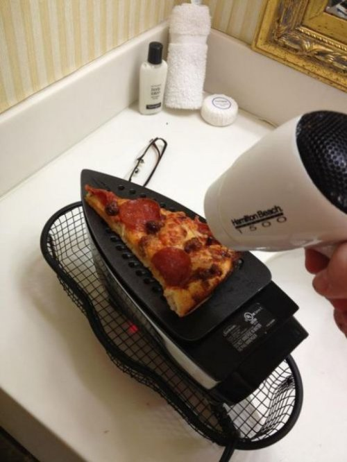 collegehumor:   How Not To Heat Up Pizza   They shape the iron like a slice for a reason.