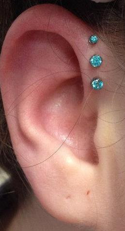 Forward helix piercings done by Cody at Creative Visions Tattoo & Piercing in Monterey, CA. Jewelry from Anatometal
