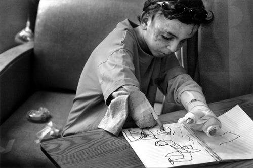 ummhurayrah:   Saleh, an Iraqi child, drawing airplanes that are dropping bombs, with a marker taped to his amputated arm.  This is probably the picture that has moved me the most ever since i started tumblr. I always go back to look at it on my blog. Words can't explain the emotions that I go through when I look at this boy. I seriously just want to hug him tight. No child deserves to end up in this state.