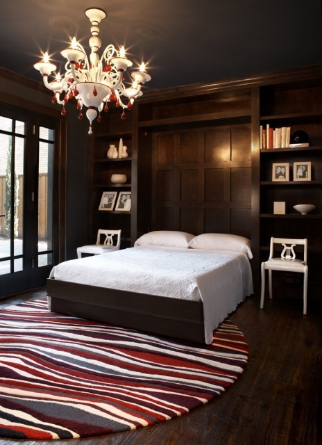 I love the dramatic impact the white, red, and gray accent pieces have against the dark wood of this bedroom (via Beth Dotolo, RID, ASID, LEED AP)
