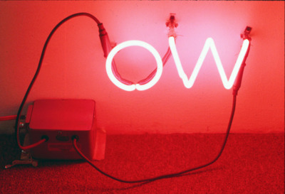 "o.w. 1989 neon 12"" x 8""  Showed this at Mincher/Wilcox gallery in San Francisco.  I made a few neon pieces around that time. I remember liking the idea of an angry little ""ow"" down in the corner of the room: quiet but radiating hurt.  It's also Oscar Wilde's initials."