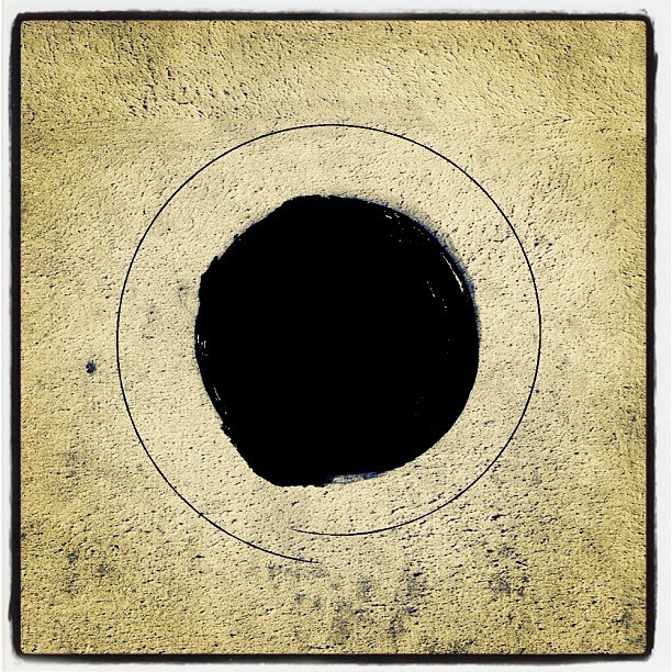 #black #tinyplanet on #beige #concrete (Taken with instagram)