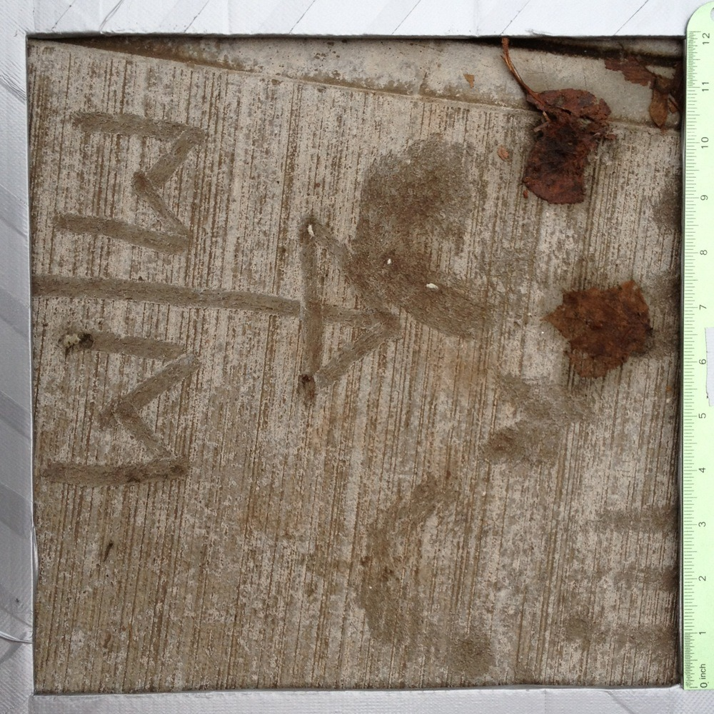 "Graffiti in wet cement, ""M + M"", hand prints, arrow symbol, NE Alberta St."