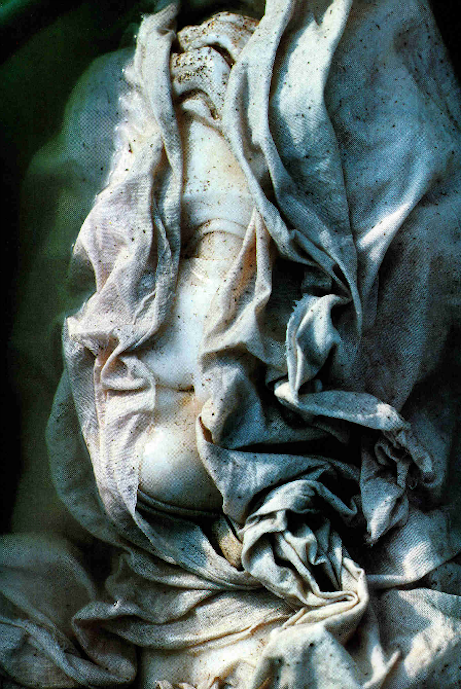 Veiled to uncover her beauty, the head of a second-century A.D. Aphrodite soaks in water to loosen encrustations and to leach damaging impurities that have penetrated the marble