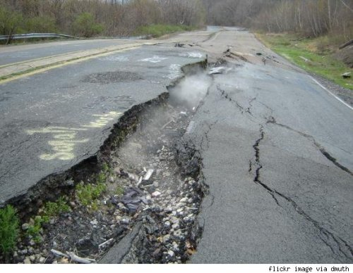 johnhateseveryone:   Location: Centralia, Pennsylvania, United StatesStory: The entire city of Centralia was condemned by the state of Pennsylvania and its zip code was revoked. The road that once led to Centralia is blocked off. It is as if the city does not exist at all, but it does, and it has been on fire for almost fifty years. In 1962, a fire broke out in a landfill near the Odd Fellows cemetery. The fire quickly spread through a hole to the coal mine beneath the city, and the fires have been burning ever since. Smoke billows out from cracks in the road and large pits in the ground randomly open up releasing thousand degree heat and dangerous vapors into the air. The city has been slowly evacuated over the years, though some residents have chosen to stay, believing that the evacuation is a conspiracy plot by the state to obtain their mineral rights to the anthracite coal reserves below their homes. Smells like lawyers to me.Abandoned since: still marginally occupied by 10 or so brave souls  REAL LIFE SIlENT HILL  Creepy. I gotta go.