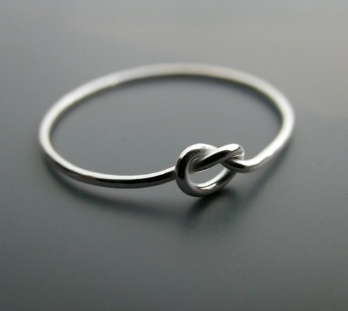 "A ""knot"" ring. The ring symbolizes a knot that is not quite tied yet, but has all intentions of being tied. A promise ring."