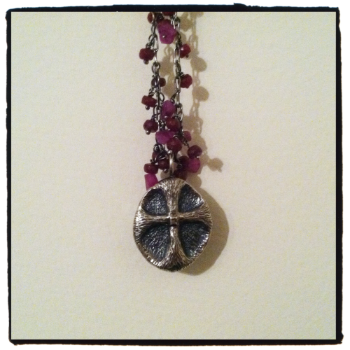 My own silver shamrock cross on a silver and ruby chain