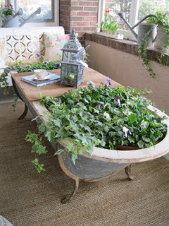 Bathtub = planter = coffee table (via Garage Sale Gal; spotted on Pinterest, via Misha Penton)