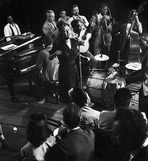 castillademusic:  Billie Holiday singing fine and mellow with Cozy Cole, James P. Johnson during jam session in studio of LIFE. Photo: Gjon Mili, 1941   To be a fly on that wall.