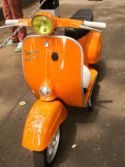 I always love an orange scooter! The Vespa 100 sport was produced bt 1978-1984 (endilletante)