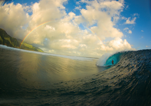 Tahitian Surfing Photography Perfection Photo by Zak Noyle - Zak captured a rare moment at Teahupoo through his fisheye lens, combining barrels, blue water, sunlit mountains and a full freaking rainbow. Surfing Pictures and Videos