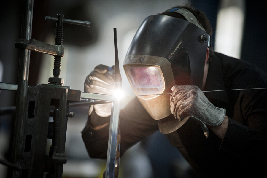 An employee welds a specialized metal product in the shop at the Amuneal Manufacturing Corp. plant in Philadelphia on Jan. 9, 2012.  Amuneal Manufacturing Corp., founded in 1965, is a metal fabrication company specializing in magnetic shielding and custom fabrication. Photograph by Paul Taggart/Bloomberg