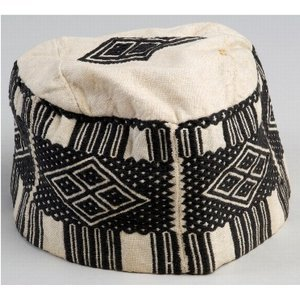 Mandingo' Cap A  'Mandingo' cotton embroidered cap. It is decorated with five rectangular  side panels with a central diamond shape, and three panels on the flat  top. 'Mandingo' in this context refers to a style of decorated work  traditionally worn by Muslim elites