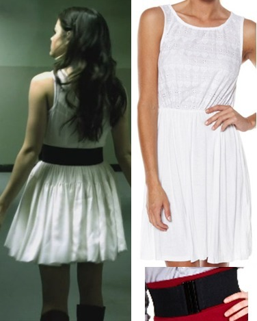 Aria's white dress is floaty and cool. I couldn't find a picture that worked well without objects interfering from the front, but the dress looks great from the back too! Pair a simple white summer dress with a wide black belt to get Aria's cool summer look. Being Aria, she also paired it with knee high black boots.  Under $20 Belt:   American Apparel Elastic Belt - $11.00  Under $50 Dress:  Surf Stitch White Dress - $26.97