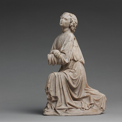 An alabaster statue of a kneeling angel, from c. 1430-40. The statue was made in Burgundy and stands at only 14.5 inches high. The angel was originally part of a collection made by a group of anonymous sculptors that depicted either the Annunciation or Christ as the Man of Sorrows.