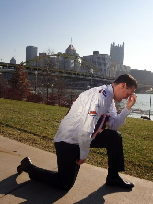 "thedailywhat:  Adding Tebowing To Injury of the Day: Making good on his bet with Denver mayor Michael Hancock, Pittsburgh mayor Luke Ravenstahl tebows the Steel City's skyline while wearing a No. 15 Denver Broncos jersey. ""This is not something I ever thought I'd have to do, and it certainly wasn't something I was looking forward to,"" Ravenstahl told the press. ""However, we're good sports here in Pittsburgh and I want to congratulate Denver on a great win."" [cnn / photo: @wearedenver.]  Pittsburgh mayor Luke Ravenstahl #Tebowing"